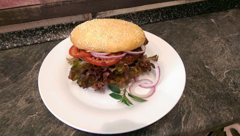 Unser leckerer hausgemachter Veggie-Burger je nach Geschmack mit verschiedenen Toppings